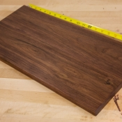 After: same walnut panel after 3 coats of tung oil varnish applied by wet-sanding. Once dry, paste wax was applied and buffed to a semi-gloss sheen
