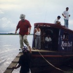 Keith Stephens steps off a water taxi after checking out logs in Peru