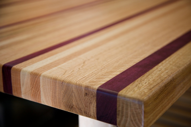 a 170 pound purple heart red oak table by doug johnson