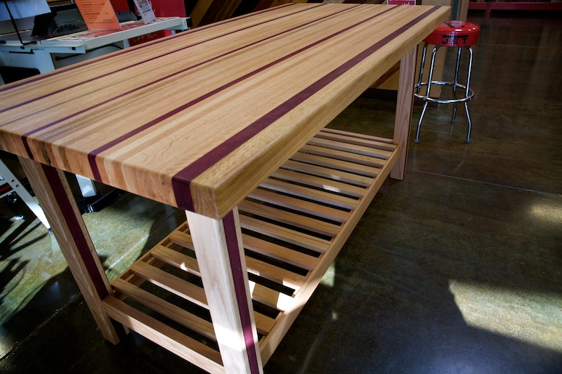 The purple heart gives the whole thing a wild look. A 170 Pound Purple Heart   Red Oak Table by Doug Johnson