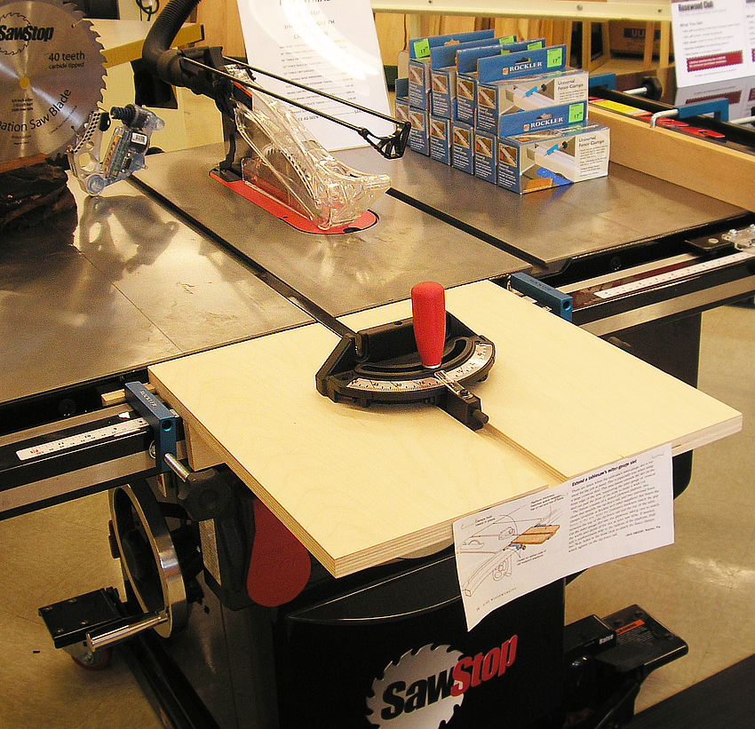Miter extension on a  table saw improves capacity and safety when cross cutting wide stock